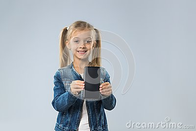 Little Teenage Girl Show Cell Smart Phone Screen With Empty Copy Space, Small Kid Happy Smiling Child