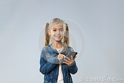 Little Teenage Girl Using Cell Smart Phone, Small Kid Happy Smiling Child