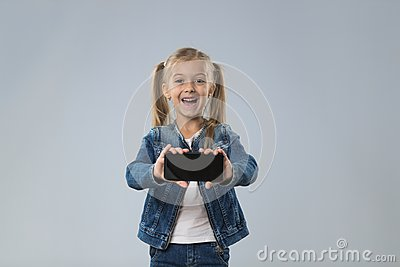 Little Teenage Girl Show Cell Smart Phone Screen With Empty Copy Space, Small Excited Happy Smiling Child