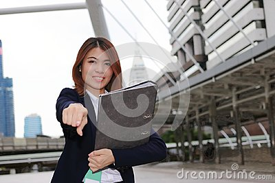 Leadership business female concept. Attractive young Asian businesswoman standing positive posing and looking at camera in outside