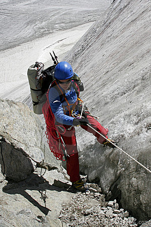 Alpinist on glacier.