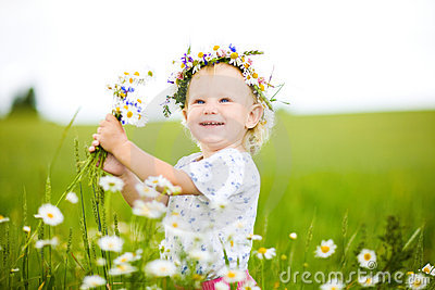 Small girl with field flowers
