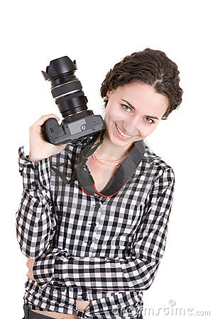 Beautiful girl holding a photo camera