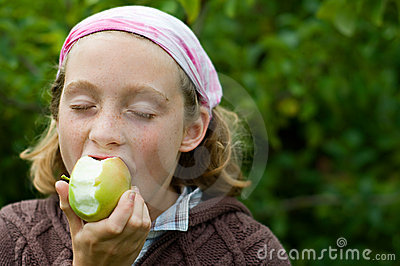 Girl enjoying an apple