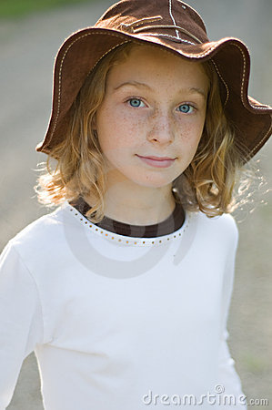 Young girl in a sun hat