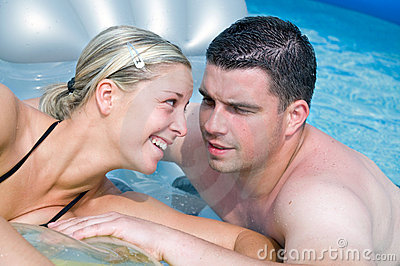 Happy couple in a pool