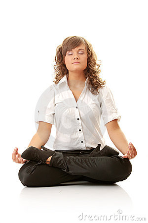Businesswomen meditating in lotus position