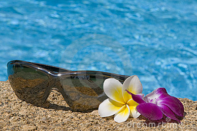 Tropical flowers and sunglasses