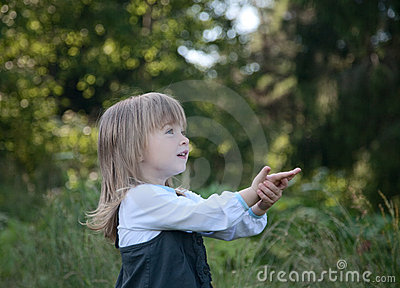 Little girl on a background of  wood