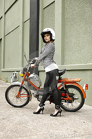 Stylish woman with moped