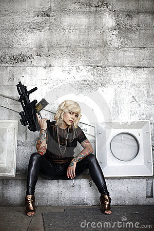 Stylish woman with assault gun