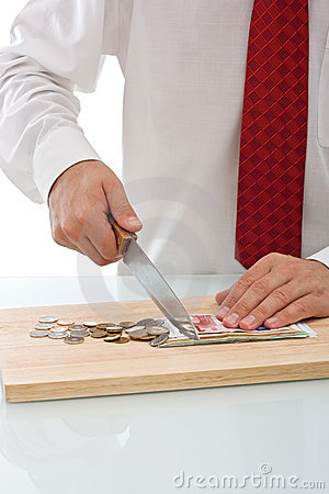 Businessman cutting the currency
