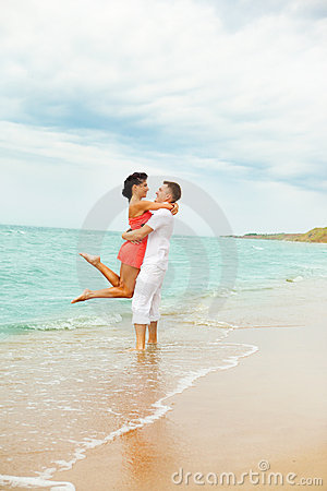 Laughing couple at the beach