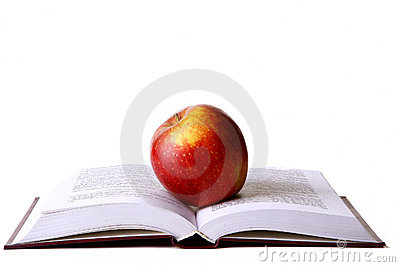 Opened student book with red apple