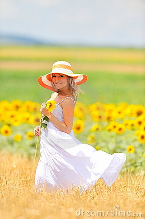 Beautiful woman on field in summer