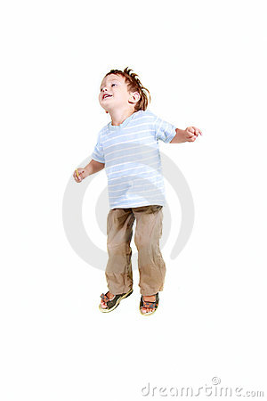 Happy young boy jumping