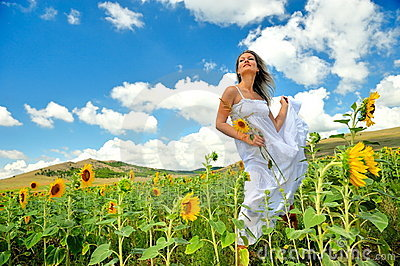 Beautiful woman on sunflower field