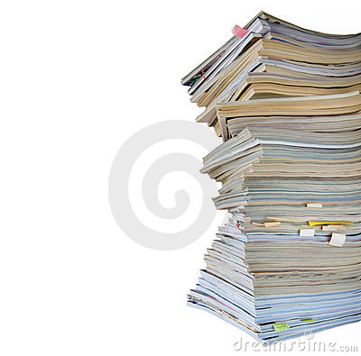 Stack of worn magazines and journals,isolated