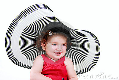 Toddler girl in big hat