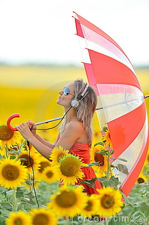 Beautiful happy woman listening to music outdoor