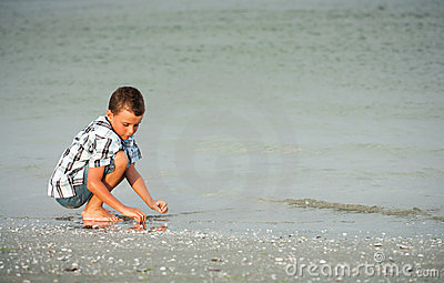 Child on sea shore