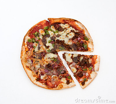 Pizza with slice isolated against white background