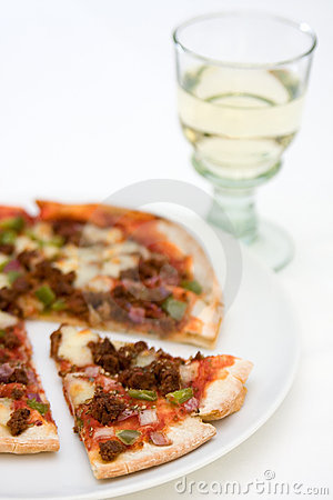 Pizza and wine glass over white
