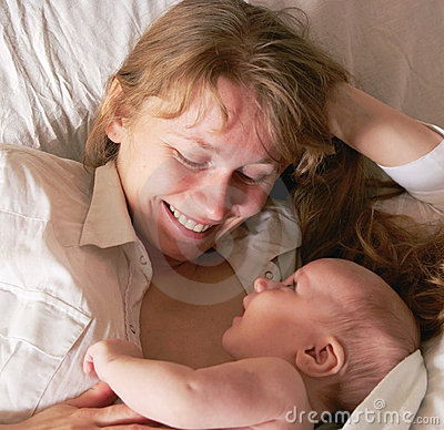 Happy newborn baby and mother