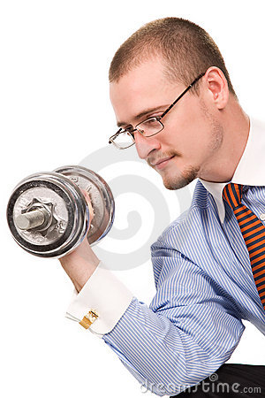 Handsome businessman exercising with dumbells