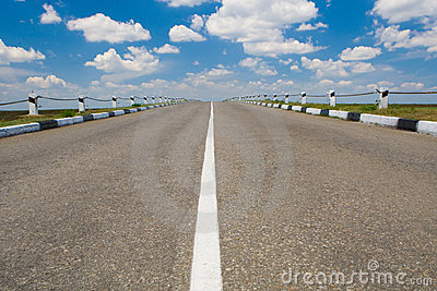 Empty highway with blue sky