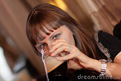 Drinking young woman