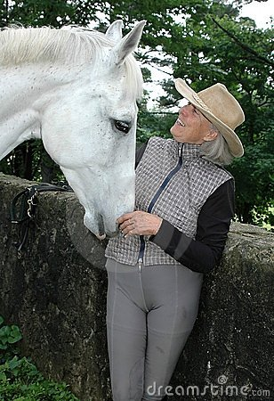 Senior woman equestrian with horse