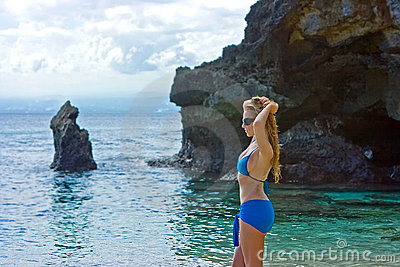 Girl standing on the beach on Bali