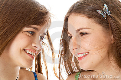 Two laugh teenage girls