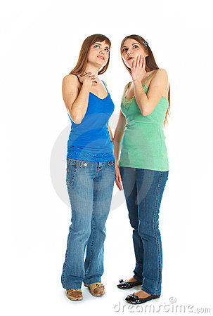 Two teenage girls looking up