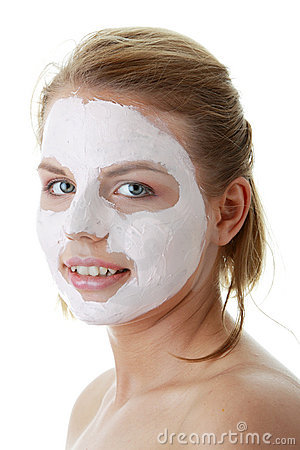 Young female face with clay mask