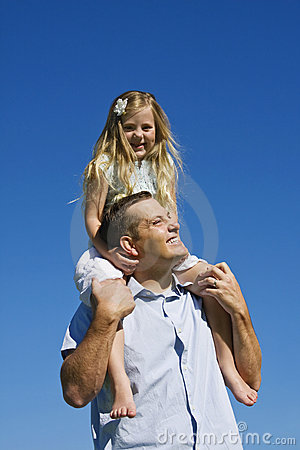 Young girl on Fathers Shoulders