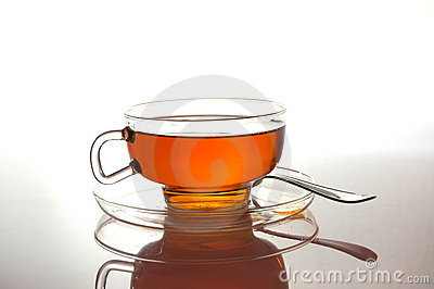Cup of tea on white with reflection