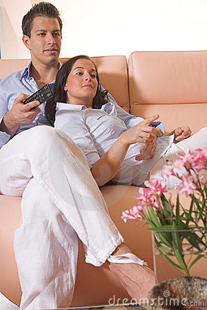 Young couple watching tv on the couch