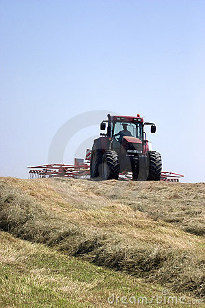 Haymaking:  tractor turning hay.