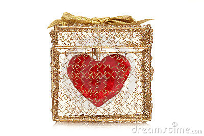 Red heart in a golden gift box