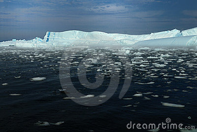 Icebergs, one with blue stripe