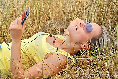 Beautiful happy woman listening to music