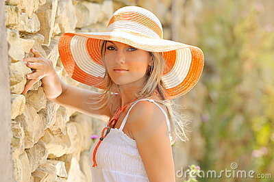 Pretty young woman with hat