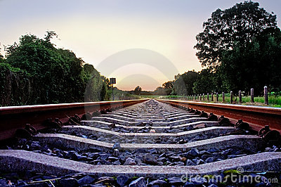Railway tracks with pale pastel sunset