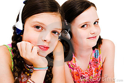 Portrait of girls listening music on headphones