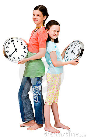Cute girls holding clocks