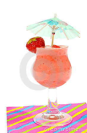 Glass of strawberry smoothie with small parasol