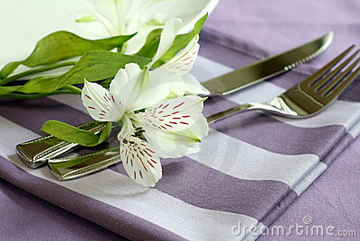 Plate, knife, fork and flowers.