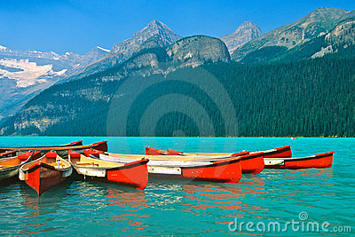 Mountain Lake and Canoes